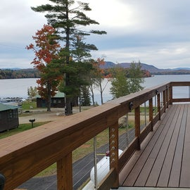 The bathhouse is a short walk from a parking are on the road, just before it descends toward the lake. Wrap around deck gives nice views of the lake. showers on this side, laundry close to the front of the building. Ramp leads to the back, steps from below.