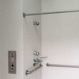 Coin operated showers. This is an accesssible one, without a lip into the shower area and upper and lower shower heads. 2020: $0.75/3 minutes and then 0.25/minute after that.