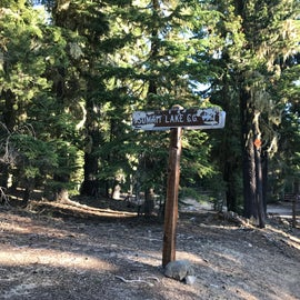 The little sign from the road indicating there is a campground close.  If you blink you can miss it.