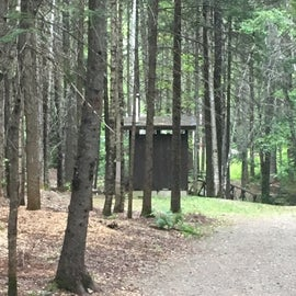 Outhouses were strategically located, clean, and well maintained.