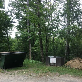 There is a bear proof dumpster and a recycling center, but no dump station for RVs.