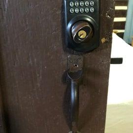 Code lock on front door of cabin