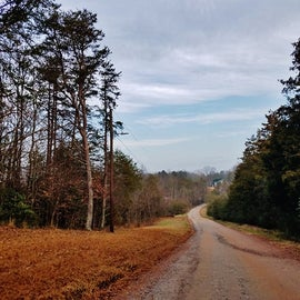 Getting to the campground is by way of several country roads and this dirt road, which has a few potholes.