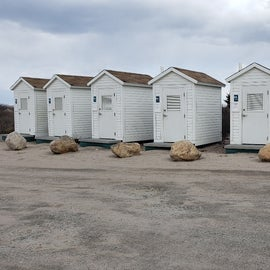 Rural composting toilets available for public use. There's a public parking area for the beach next to the campground.