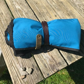 Belmont Blanket, rolls up compact with an adjustable leather strap and faux fossil rocks which are distributed all over the campground for fun finding