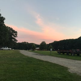 Open field in the middle of the very wooded campground makes for excellent star viewing and sunsets!
