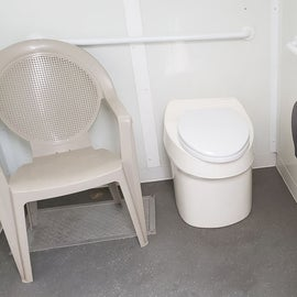 Clean composting toilets with waterless hand cleansure.