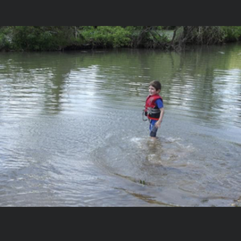 My youngest son playing in the river