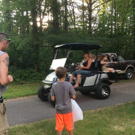 Golf cart parade - throwing candy to the kids