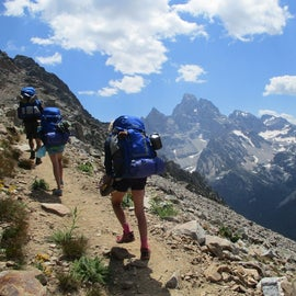 Climbing up out of North Cascade, up Paintbrush divide. Grand in the background.