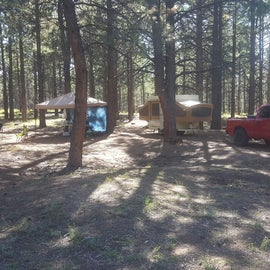 """One of the sites with a tent, """"meal tent"""", and a pop up camper"""