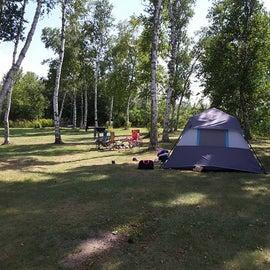 Tent site along the lake shore.