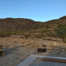 campsite D - grill, table, firepit and a level area for a tent.  There is no electric or water for campers in this park.