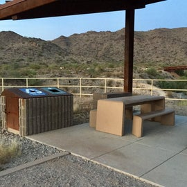 Ramada at the trail head has solar lighting in the shade structure, seating, trash and recycle receptacles.