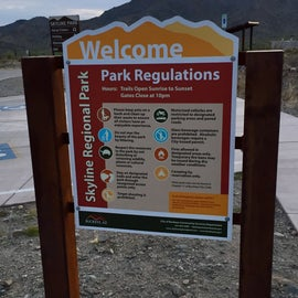 Welcome sign and rules for the park - even though the trails close at sunset, many mountain bikers stay out on the trails after dark with headlamps and return to the parking lot late into the evenings.