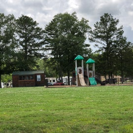 Playground and one of the camping cottages sit in between Mack Smith Rd and the sunny section of full services sites.