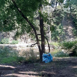 This was our campsite after we spent an hour clearing it. We bagged our trash and left it. They never came by to collect trash. Others just threw their trash on the ground.