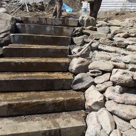 New granite stairs leading down to the river at the Beecher Falls Access area