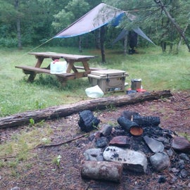 Campsite with large fire ring which could use some maintenance.