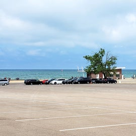 3 mile's of beach with store, food trucks and several bathrooms/changing rooms
