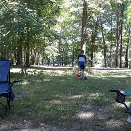Site J522, playing soccer in the woods.