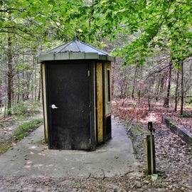 Pit toilet and water