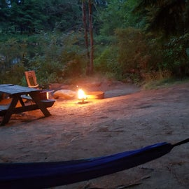 Evening by the campfire. There is a slope at the back of Site 26 and then it levels off again Pemi River Campground