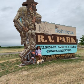 Cute RV Park sign - could use a little TLC, but my girls thought it was magnificent, all the same