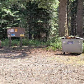 Campground entrance and info board.  2 dumpsters for trash.