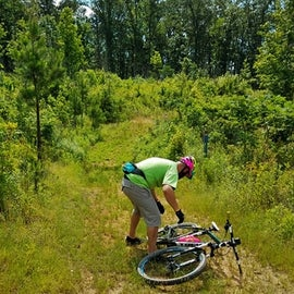 My son and I enjoyed the bike trails.  Here he is adjusting the chain on his bike.