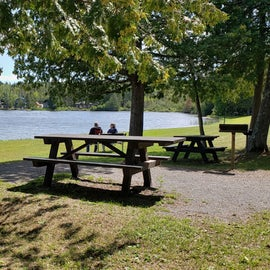 Waterfront with picnic tables