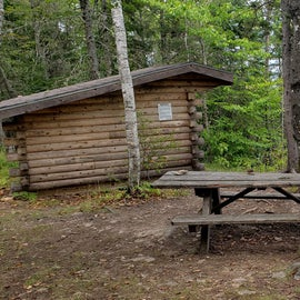 Lean to with picnic table and a view