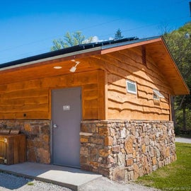Clean campground restrooms, coin operated showers, recycling bins for campers