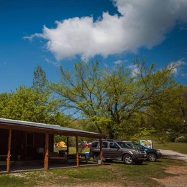 Bunkhouse with porch swings, ceiling fans, picnic tables, grill and fire ring