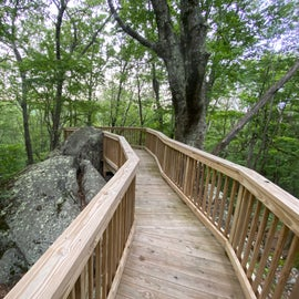 Yurt boardwalk incorporating natural rocky landscape into its structure...very cool touch.