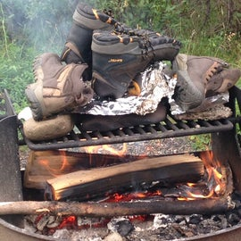 Don't dry your hiking boots directly on the fire