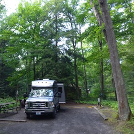 Jack, our RV. Site looks level, but has a definite uphill grade.