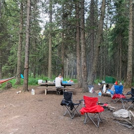 Spacious campsite at the end of the road. Cooling shade, plenty of flat spots for tents, and lots of trees for hammocks!