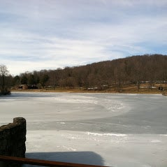 Twin Lake, frozen over in winter.  The beach, picnic area, and rustic old CCC buildings are on the opposite shore.