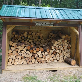 Firewood for the cool fire ring by the pavilion.