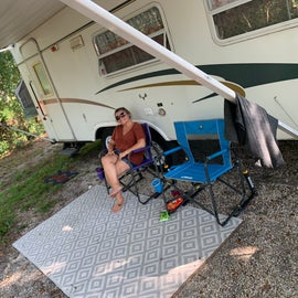 My beautiful wife relaxing outside of our camper!