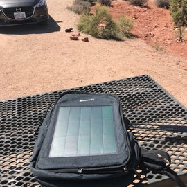The Renogy Solar Backpack in full sun charging away.  The front panel is removable and has a pocket so your charging electronic doesn't have to be in the sun as well.