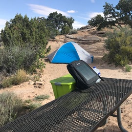 Charging my stuff while there is sun.  The clouds came and went while I was there so I made sure to get the panel out in the full sun for maximum efficiency.