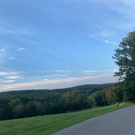 On top of the hill where a nature center is located , basket ball court, baseball field, water park and pavilion spaces.
