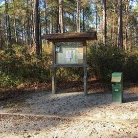 Entrance sign in and registration.  The 24 hour volunteer campground forrest ranger is one site up on the right.