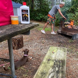 Our tent is in the background. There are three lantern post at this site. The grill area combo combines a fold down grill with the outer edge for the fire ring.