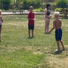 Water balloon games distanced and within family groups for kid activities