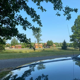 View looking out from site 10 toward pond and nearby pool bathhouse