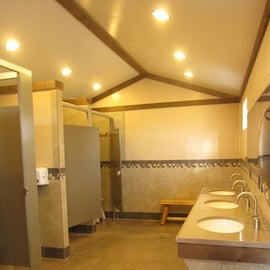 Clean bathrooms with wide private shower stalls - main bathhouse