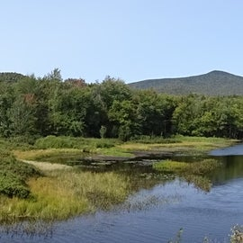 Panorama of Lewey Lake, the campground is to the left, and behind the trees in the center.